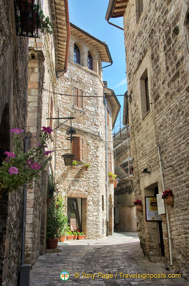 Medieval cobbled street leading to Rocca Maggiore