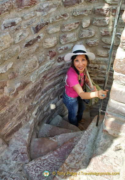 Squeezing my way down the spiral staircase of La Rocca