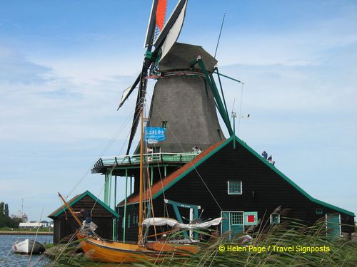 At Zaanse Schans, you can experience the workings of a traditional windmill.