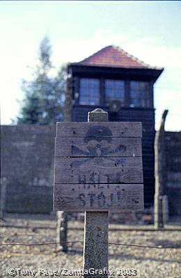 A warning sign at the camp fence