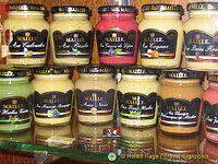 Colourful jars of Dijon Mustard