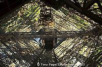 Looking up inside the lift shaft of one pillar of the Eiffel Tower
