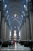 The aisles are divided by giant pillars and lit from all sides by excellent stained glass