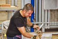 With great skill of the glassmaker, the hot glass begins to take shape