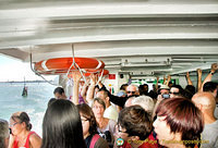 Riding the very crowded vaporetto to Burano
