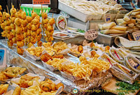 Freshly cooked fish and chips and other seafood at La Boqueria