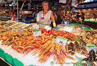 This stall sells cooked prawns and shellfish
